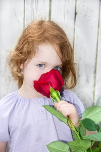 Memory consolidation - photo of girl smelling a rose