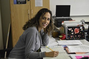How to organise yourself to get better grades - photo of woman studying