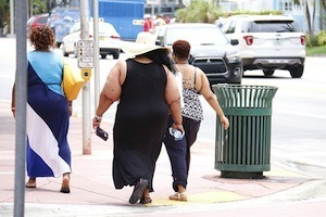 Overcome insomnia to avoid bad health - photo of overweight people