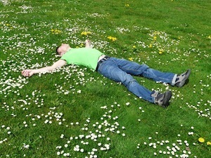 Under Cover - sleep positions - photo of man asleep on the grass