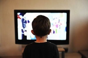 Are you sitting comfortably? Photo of boy watching TV