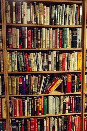 Genius thinking. Photo of bookcase
