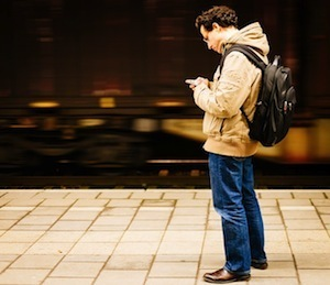What's sticky and won't let go? Photo of man and smart phone