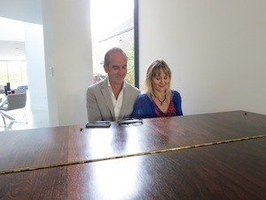 Photo of Lysette Offley and Kevin McCloud playing piano