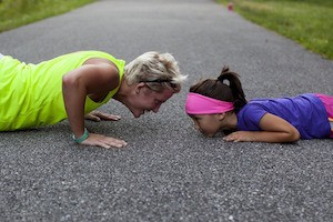 You can be glad about that - photo of mother and daughter doing push-ups